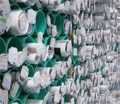 Photo of hundreds of paper plans stacked in tubes