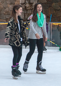 photo of two young girls skating